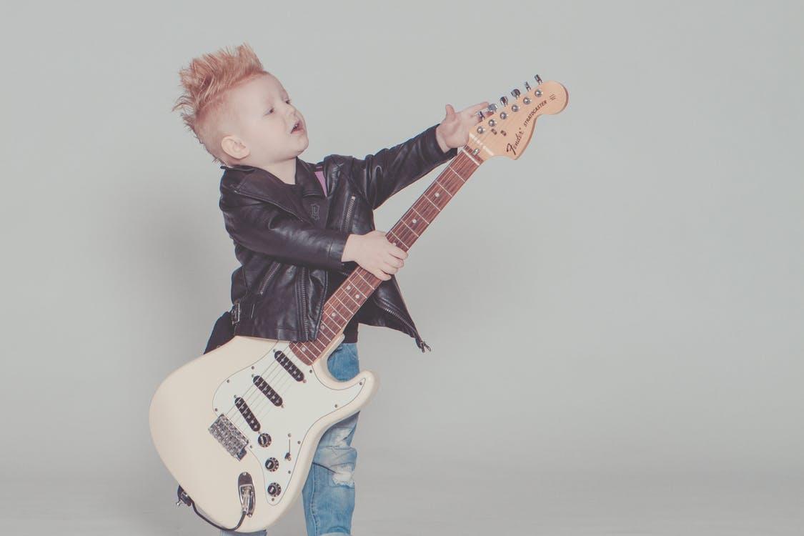 kid playing guitar rockstar