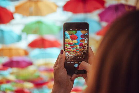 Women taking photo on iPhone
